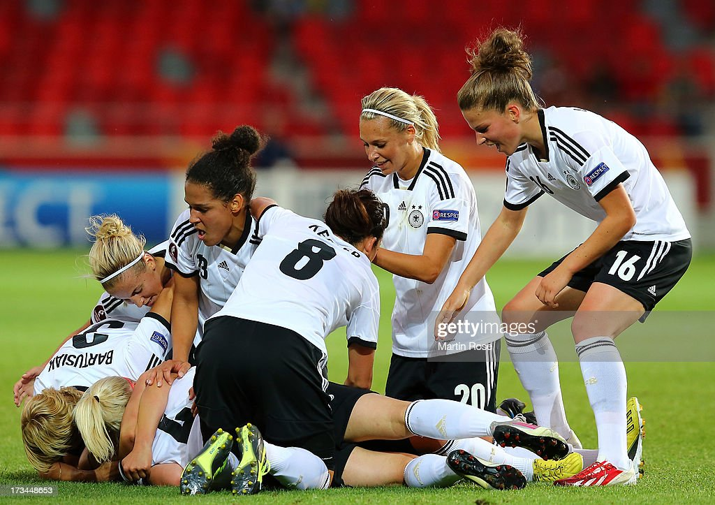 Lena Lotzen of Germany celebrate with her team mates after she scores her team's opening goal during the UEFA Women's Euro 2013 group B match between Iceland and Germany at Vaxjo Arena on July 14, 2013 in Vaxjo, Sweden.