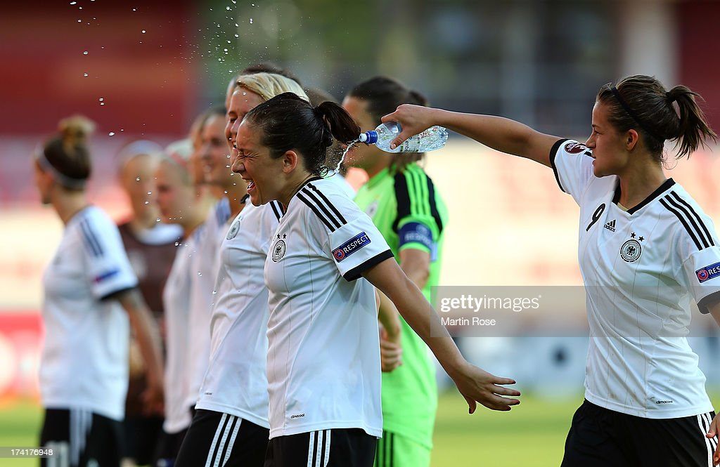 Lena Lotzen (R) of Germany celebrate with team mate Nadine Kessler (L) after the UEFA Women's Euro 2013 quarter final match between Italy and Germany at Vaxjo Arena on July 21, 2013 in Vaxjo, Sweden.