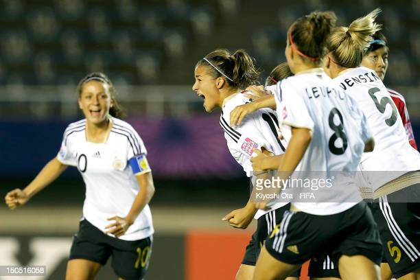 Lena Lotzen of Germany celebrates with teammates after scoring a goal against China during the FIFA U20 Women's World Cup Japan 2012 Group D match...
