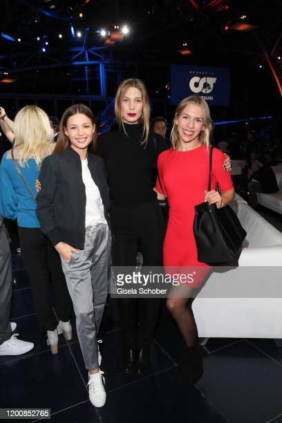Lena Meckel Sarah Brandner Julia Dietze wearing an outfit by AlphaTauri during the Scuderia AlphaTauri launch event at Hangar 7 on February 14 2020...