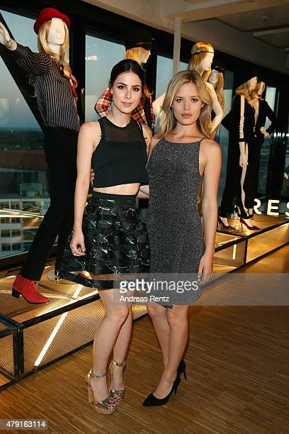 Lena MeyerLandrut and Georgia May Jagger attend the RESERVED collection preview seated dinner at upside east on July 1 2015 in Munich Germany