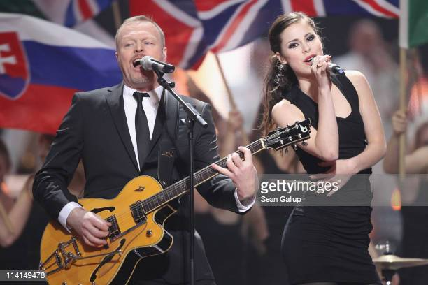 Lena Meyer-Landrut of Germany and co-host Stefan Raab perform during the dress rehearsal ahead of the finals of the 2011 Eurovision Song Contest on...