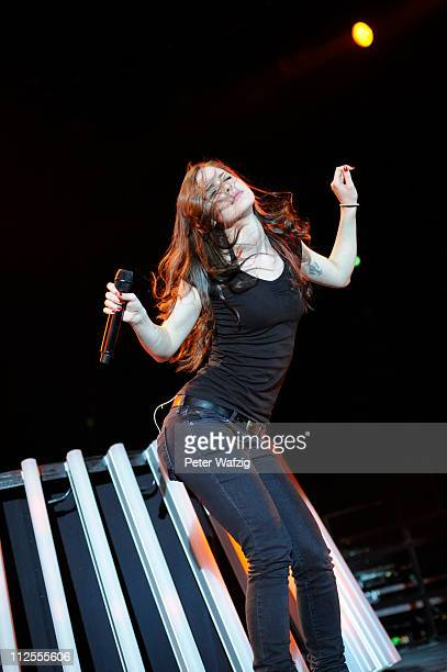 Lena MeyerLandrut performs on stage at the Westfalen Stadium on April 19 2011 in Dortmund Germany