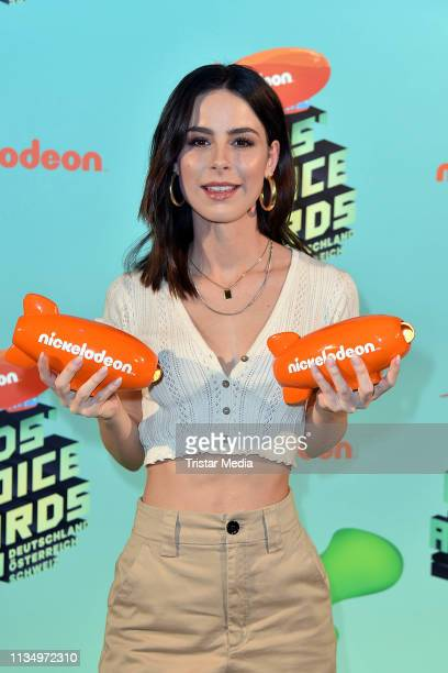 Lena MeyerLandrut poses backstage with her award at the Nickelodeon Kids Choice Awards on April 4 2019 in Rust Germany