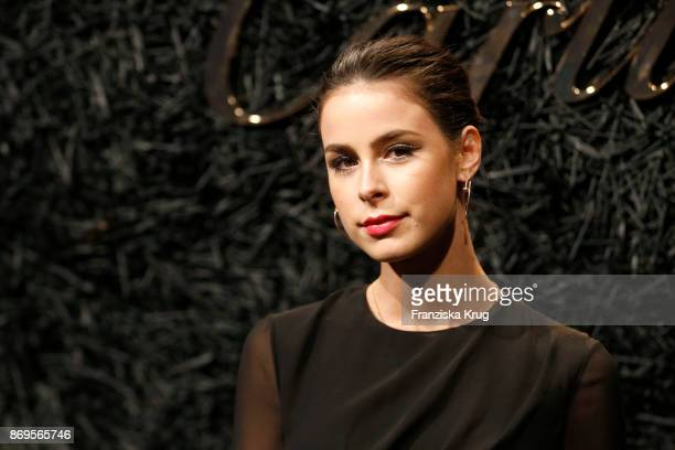 Lena MeyerLandrut wearing JUSTE UN CLOU Earrings and two JUSTE UN CLOU Bracelets attends the When the Ordinary becomes Precious #CartierParty at Old...