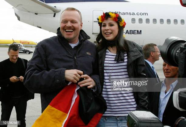 Lena Meyer-Landrut, winner of the Eurovision Song Contest 2010 and TV host Stefan Raab arrive at Hanover airport on May 30, 2010 in Hanover, Germany....