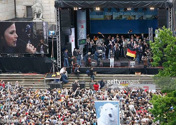 Lena MeyerLandrut winner of the Eurovision Song Contest 2010 performs her song 'Satellite' on a stage in front of the town hall on May 30 2010 in...
