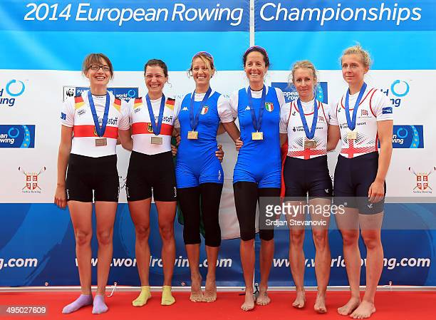 Lena Mueller and Anja Noske of Germany Laura Milani and Elisabetta Sancassani of Italy and Imogen Walsh and Katherine Copeland of Great Britain pose...