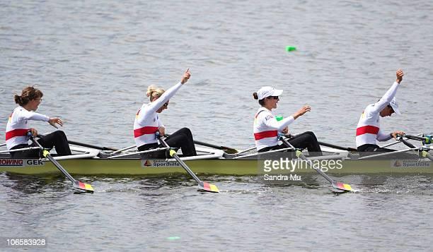 Lena Mueller Daniela Reimer Anja Noske and MarieLouise Draeger of Germany celebrate winning gold in the Women's Lightweight Quadruple Sculls Final...