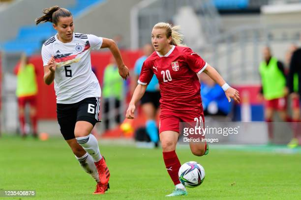 Lena Oberdorf of Germany and Tijana Filipovic of Serbia battle for the ball during the FIFA Women's World Cup 2023 Qualifier group H match between...