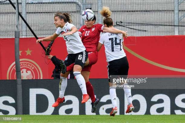 Lena Oberdorf of Germany, Dejana Stefanovic of Serbia and Lena Lattwein of Germany battle for the ball during the FIFA Women's World Cup 2023...