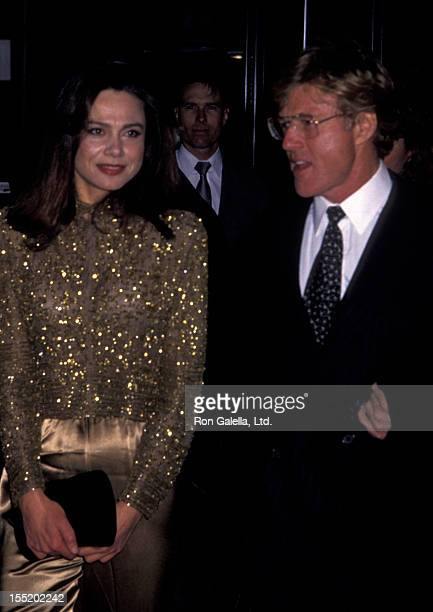 Lena Olin and actor Robert Redford attend the premiere of Havana on December 10 1990 at the Ziegfeld Theater in New York City