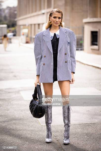 Lena Perminova, wearing a black shirt with decorated collar, blue striped blazer, grey boots and black Miu Miu bag, is seen outside Miu Miu, during...