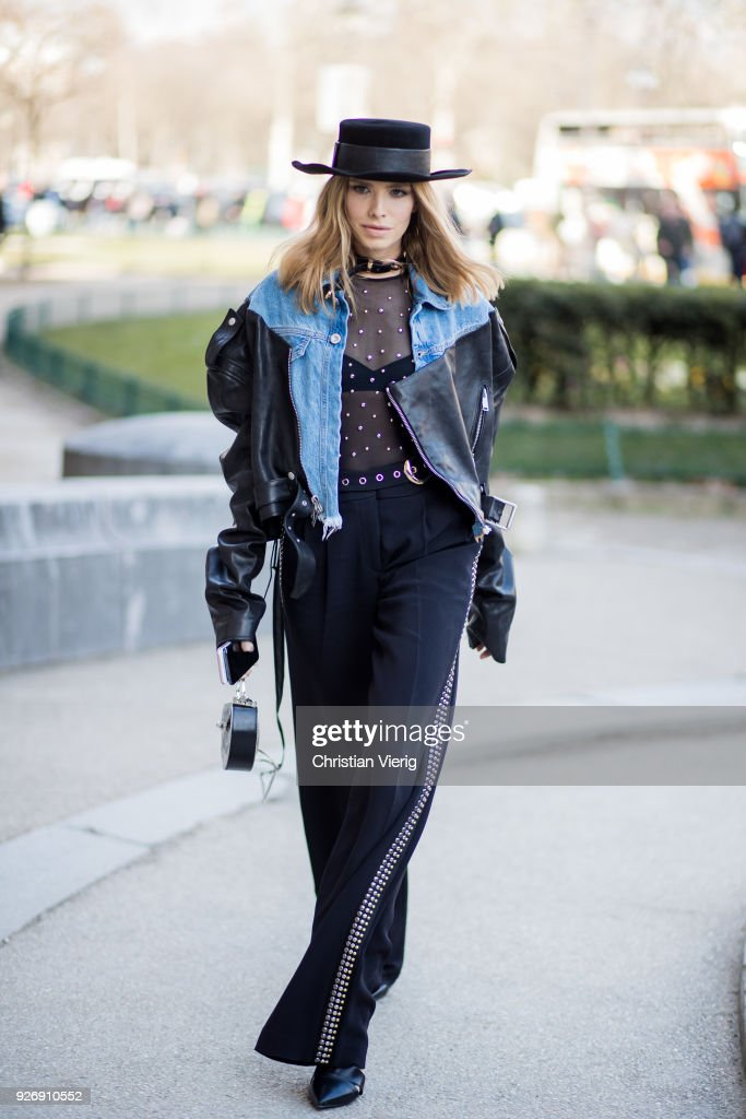 Lena Perminova wearing cowboy hat, sheer top, denim jacket is seen outside Elie Saab during Paris Fashion Week Womenswear Fall/Winter 2018/2019 on March 3, 2018 in Paris, France.