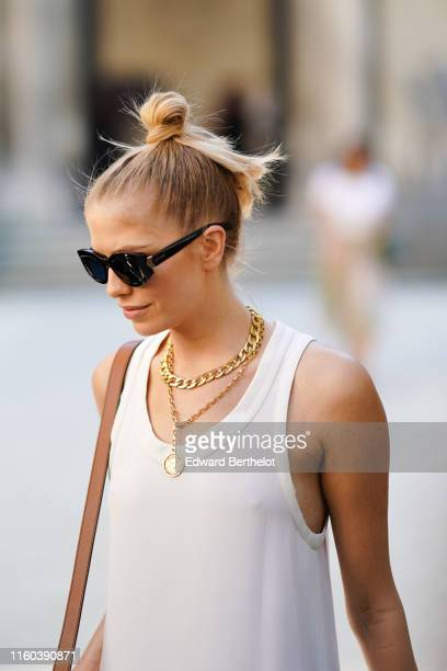 Lena Perminova wears a white dress golden necklace sunglasses outside Valentino during Paris Fashion Week Haute Couture Fall/Winter 2019/2020 on July...