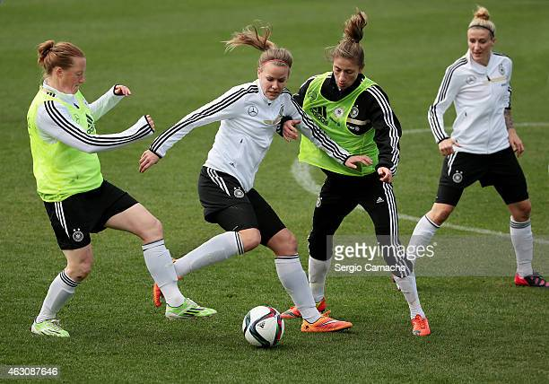 Lena Petermann duels for the ball with Melanie Behringer and Bianca Schmidt during a Germany Women's Training Session at Marbella Football Center on...