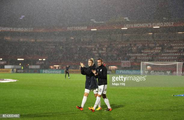 Lena Petermann of Germany applauds the fans after the game was postponed due to heavy rain during the UEFA Women's Euro 2017 Quarter Final match...