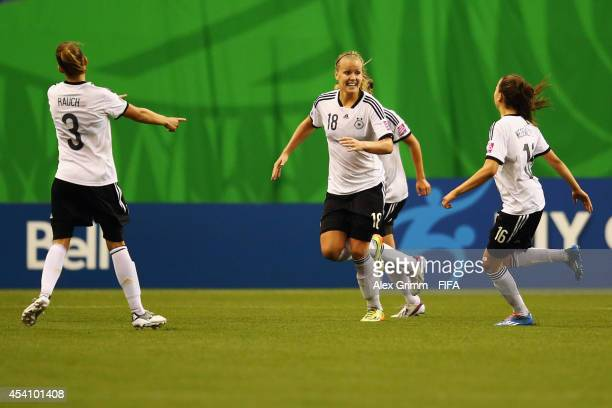 Lena Petermann of Germany celebrates her team's first goal with team mates during the FIFA U20 Women's World Cup Canada 2014 final match between...
