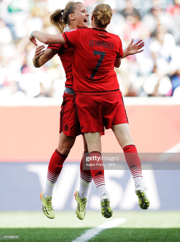 Lena Petermann of Germany celebrates with Melanie Behringer of Germany after scoring a goal during the FIFA Women's World Cup 2015 Group B match between Thailand and Germany at Winnipeg Stadium on June 15, 2015 in Winnipeg, Canada.