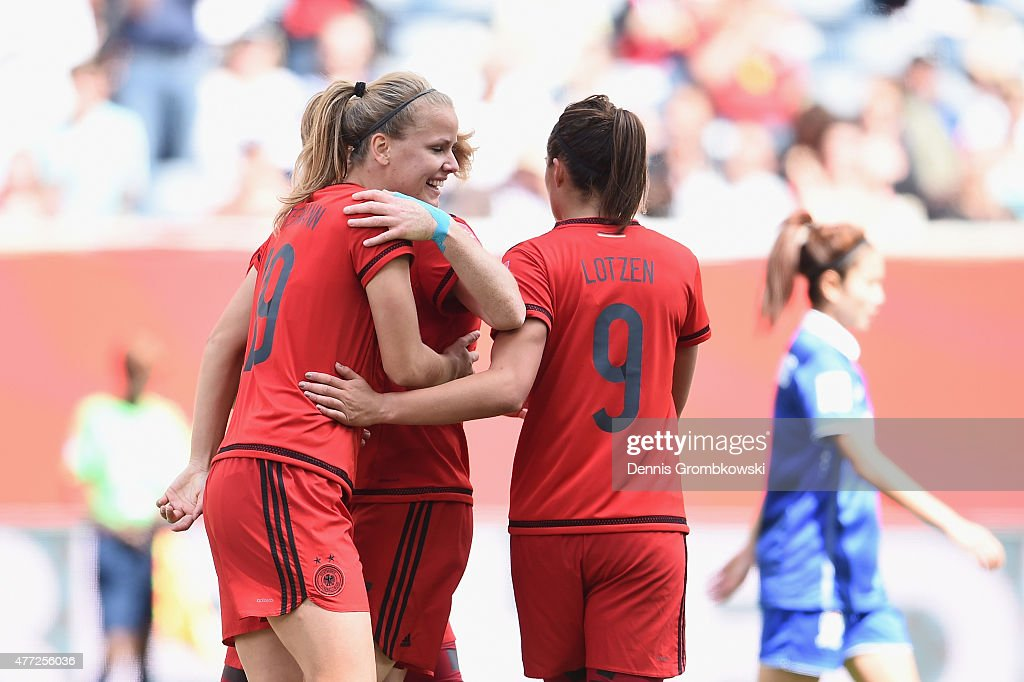 Lena Petermann of Germany celebrates with team mates as she heads the second goal during the FIFA Women's World Cup Canada 2015 Group B match between Thailand and Germany at Winnipeg Stadium on June 15, 2015 in Winnipeg, Canada.