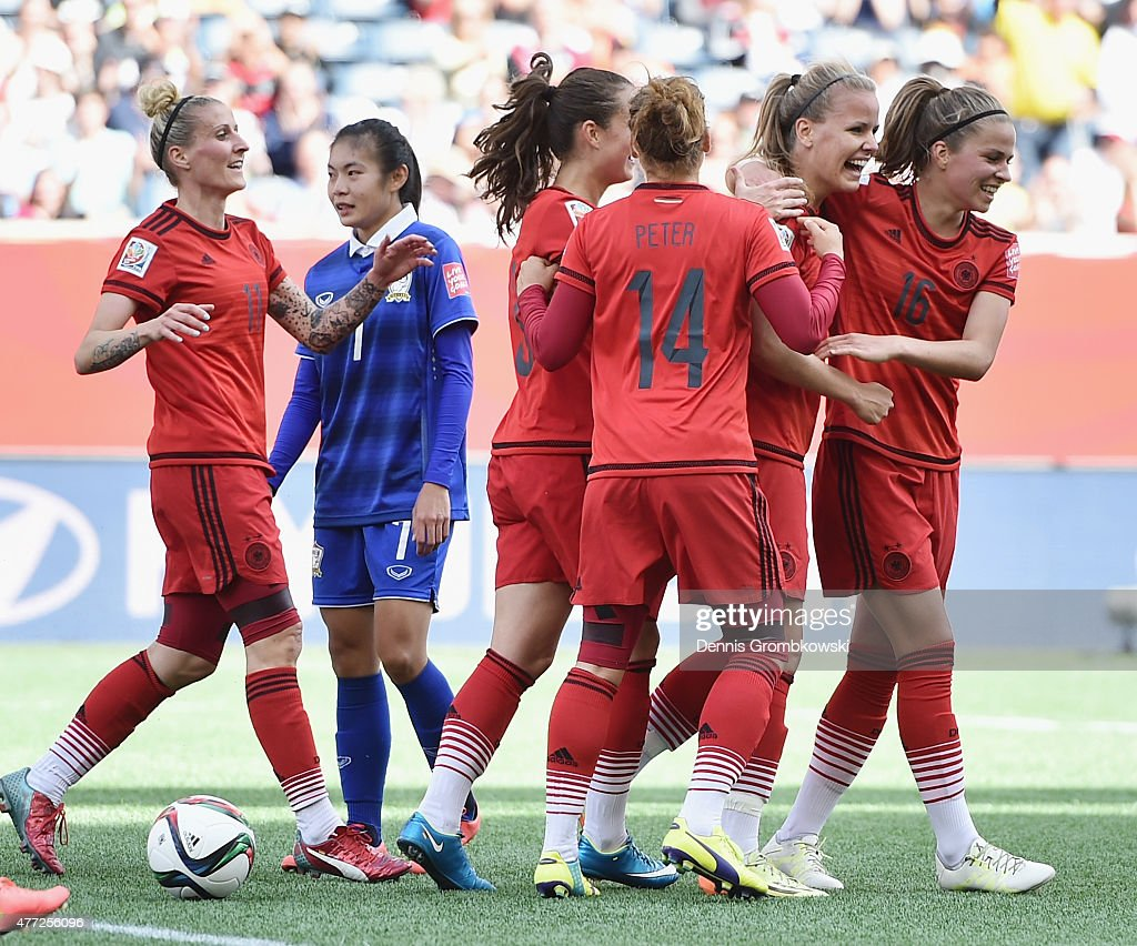 Lena Petermann of Germany celebrates with team mates as she heads the third goal during the FIFA Women's World Cup Canada 2015 Group B match between Thailand and Germany at Winnipeg Stadium on June 15, 2015 in Winnipeg, Canada.