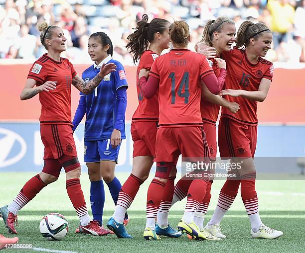 Lena Petermann of Germany celebrates with team mates as she heads the third goal during the FIFA Women's World Cup Canada 2015 Group B match between...