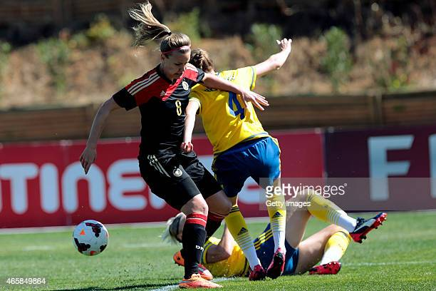 Lena Petermann of Germany challenges Emma Berlund of Sweden during the Women's Algarve Cup 3rd place match between Sweden and Germany at Municipal...