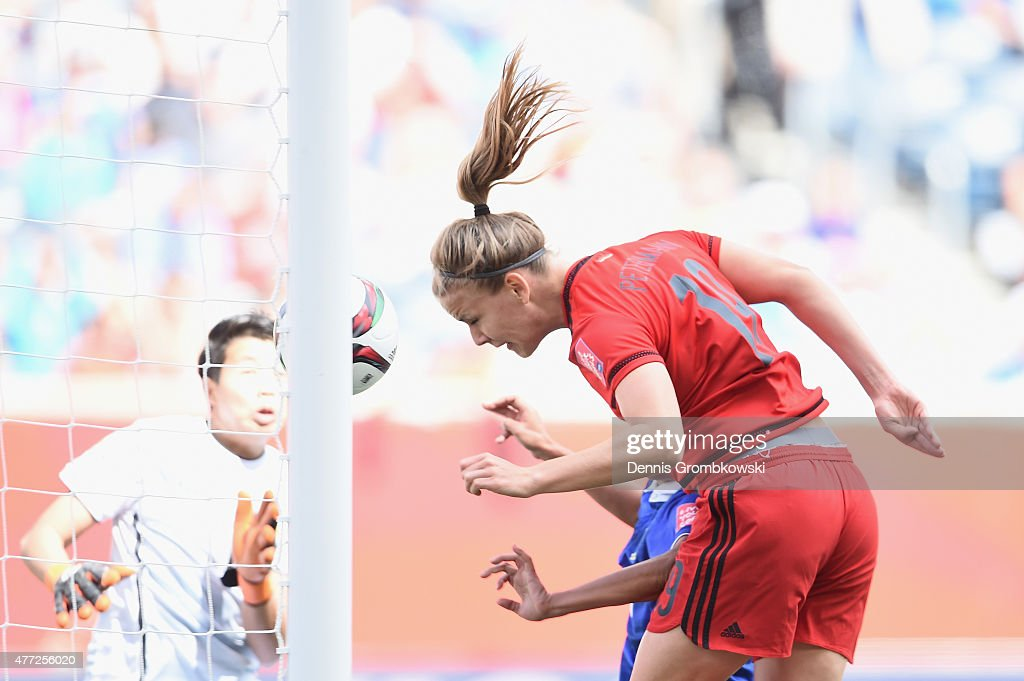 Lena Petermann of Germany heads the second goal during the FIFA Women's World Cup Canada 2015 Group B match between Thailand and Germany at Winnipeg Stadium on June 15, 2015 in Winnipeg, Canada.