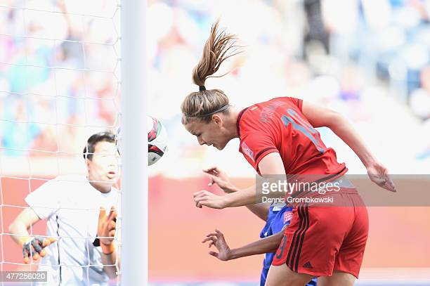 Lena Petermann of Germany heads the second goal during the FIFA Women's World Cup Canada 2015 Group B match between Thailand and Germany at Winnipeg...