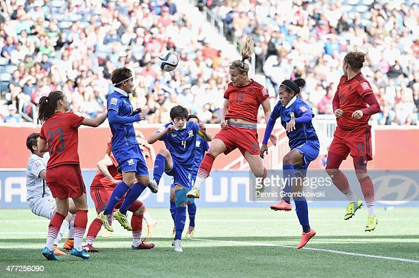 Lena Petermann of Germany heads the third goal during the FIFA Women's World Cup Canada 2015 Group B match between Thailand and Germany at Winnipeg...