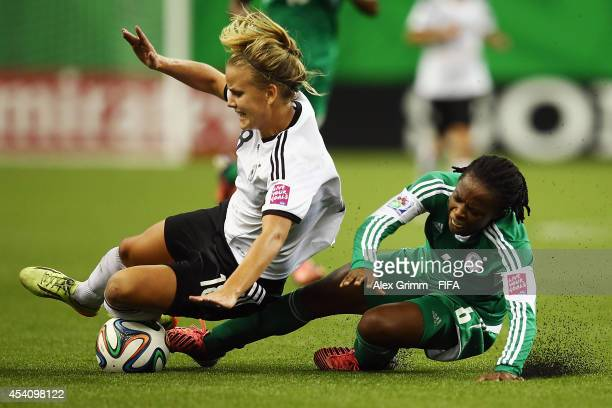 Lena Petermann of Germany is challenged by Sarah Nnodim of Nigeria during the FIFA U20 Women's World Cup Canada 2014 final match between Nigeria and...