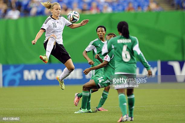 Lena Petermann of Germany jumps to kick the ball in midair in front of Osarenoma Igbinovia of Nigeria during the FIFA Women's U20 Final at Olympic...