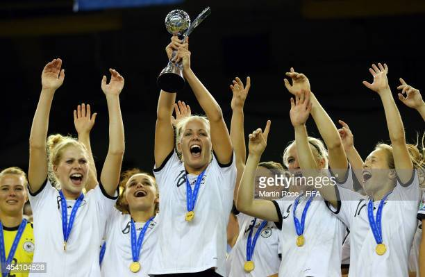Lena Petermann of Germany lifts the trophy after winning the FIFA U20 Women's World Cup 2014 final match between Nigeria and Germany at Olympic...