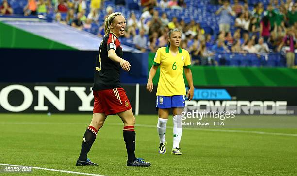 Lena Petermann of Germany reacts after she fails to score her team's equalizing goal by penalty during the FIFA U20 Women's World Cup 2014 group B...