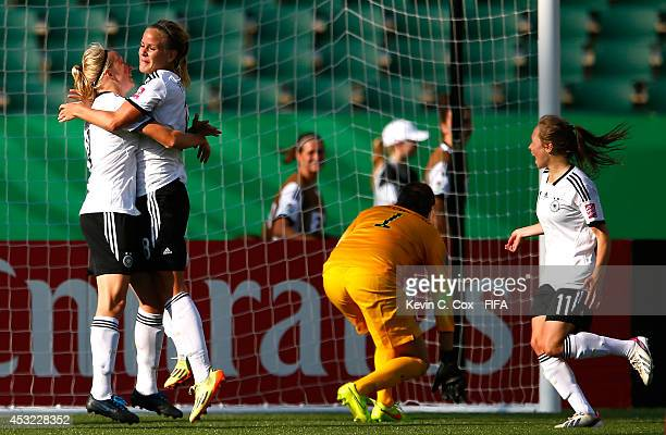 Lena Petermann of the Germany celebrates scoring a goal past goalkeeper Katelyn Rowland of the United States with Pauline Bremer and Theresa Panfil...