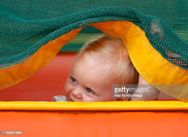 Lena Tindall plays on a bouncy castle as she attends day 1 of the 2019 Festival of British Eventing at Gatcombe Park on August 2, 2019 in Stroud,...