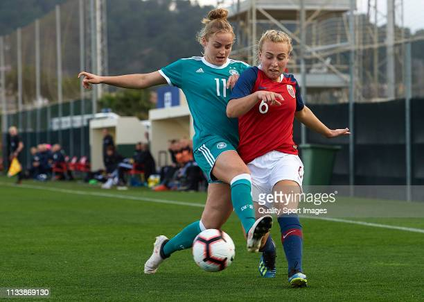 Lena Uebach of Germany competes for the ball with Vilde Gullhaug Birkeli of Norway during the 14 Nations Tournament match between U19 Women's Germany...