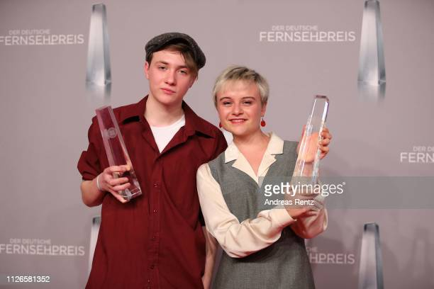 Lena Urzendowsky and Michelangelo Fortuzzi pose with their awards as best newcomer during the German Television Award at Rheinterrasse on January 31,...