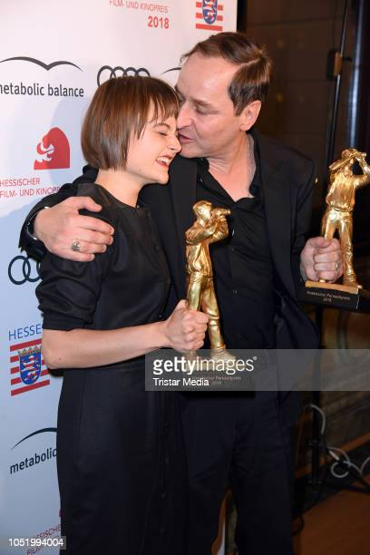 Lena Urzendowsky and Thomas Schmauser during the Hessian Film and Cinema Award at Alte Oper on October 12, 2018 in Frankfurt am Main, Germany.