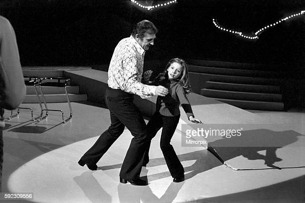Lena Zavaroni 10 yrs old has a school lesson in the make up room at the BBC theatre London with the tutor Ellis Gilmer 25 from New Zealand Lena...
