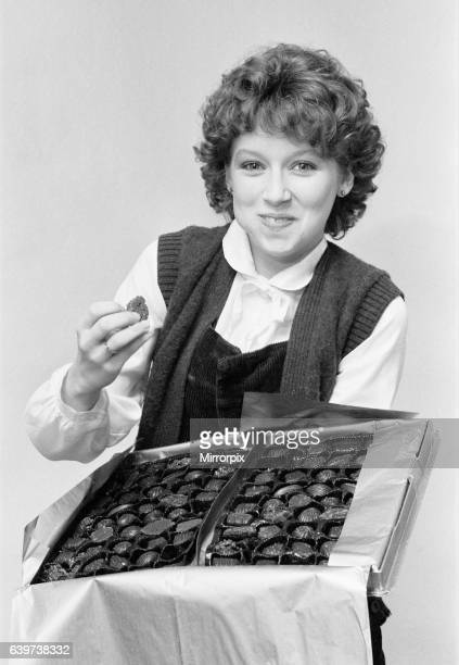 Lena Zavaroni, aged 16, eating from box of chocolates, January 1980. Lena received the chocolates from fans as a 'Get Well Soon' present after a...