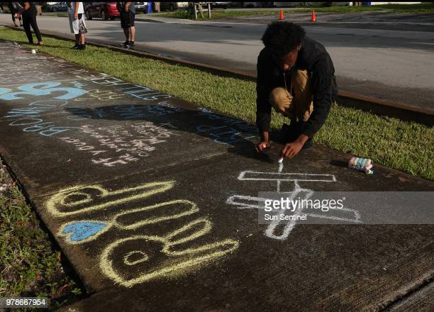 Lenar Nesmith of Pompano Beach a fan of Browardbased rapper XXXTentacion whose given name was Jahseh Onfroy visits the shooting scene on Tuesday June...