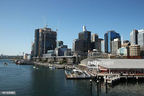 Lend Lease Group's Barangaroo redevelopment left stands under construction next to Darling Harbour in Sydney Australia on Friday Oct 2 2015...