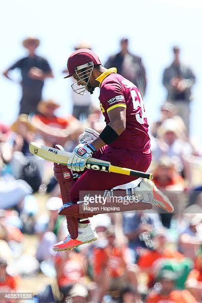 Lendl Simmons of the West Indies celebrates his century during the 2015 ICC Cricket World Cup match between the West Indies and Ireland at Saxton...