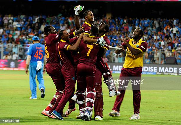 Lendl Simmons of the West Indies is congratulated by teammates after winning during ICC World Twenty20 India 2016 Semi Final match between India and...