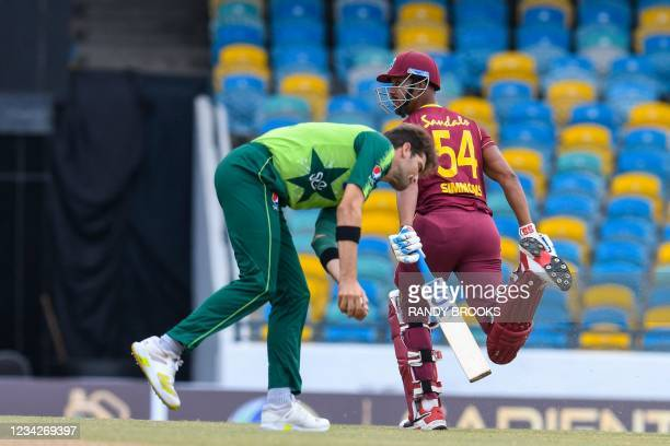 Lendl Simmons of West Indies runs as Shareen Afridi of Pakistan takes the ball during the 1st T20I between West Indies and Pakistan at Kensington...