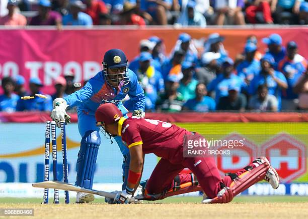 Lendl Simmons of West Indies stumped by MS Dhoni of Indiaduring the 2nd and final T20i between West Indies and India at Central Broward Stadium...