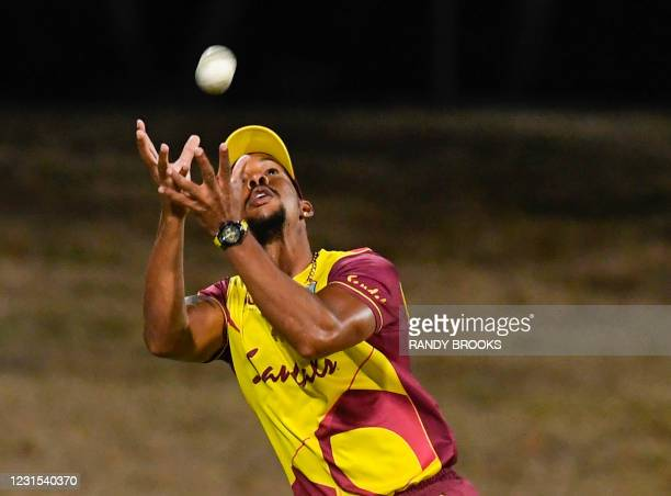 Lendl Simmons of West Indies takes the catch to dismiss Dinesh Chandimal of Sri Lanka during the 2nd T20i match between Sri Lanka and West Indies at...