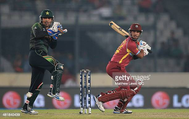 Lendll Simmons of the West Indies cuts the ball towards the boundary as Kamran Akmal of Pakistan looks on during the ICC World Twenty20 Bangladesh...