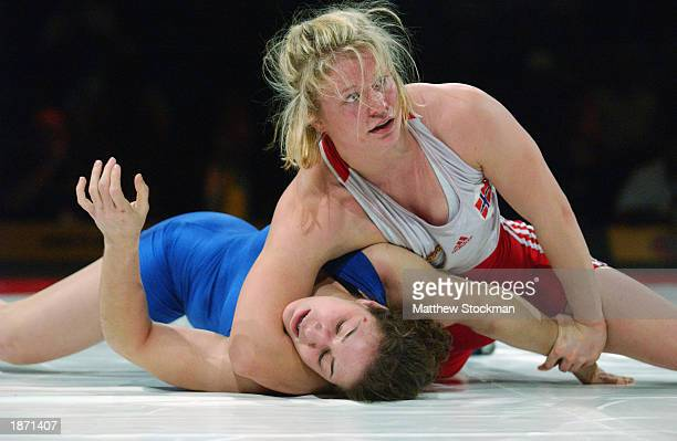 Lene Aanes of Norway wrestles Sara McMann during the Titan Games on February 15, 2003 at the Event Center at San Jose State University in San Jose,...